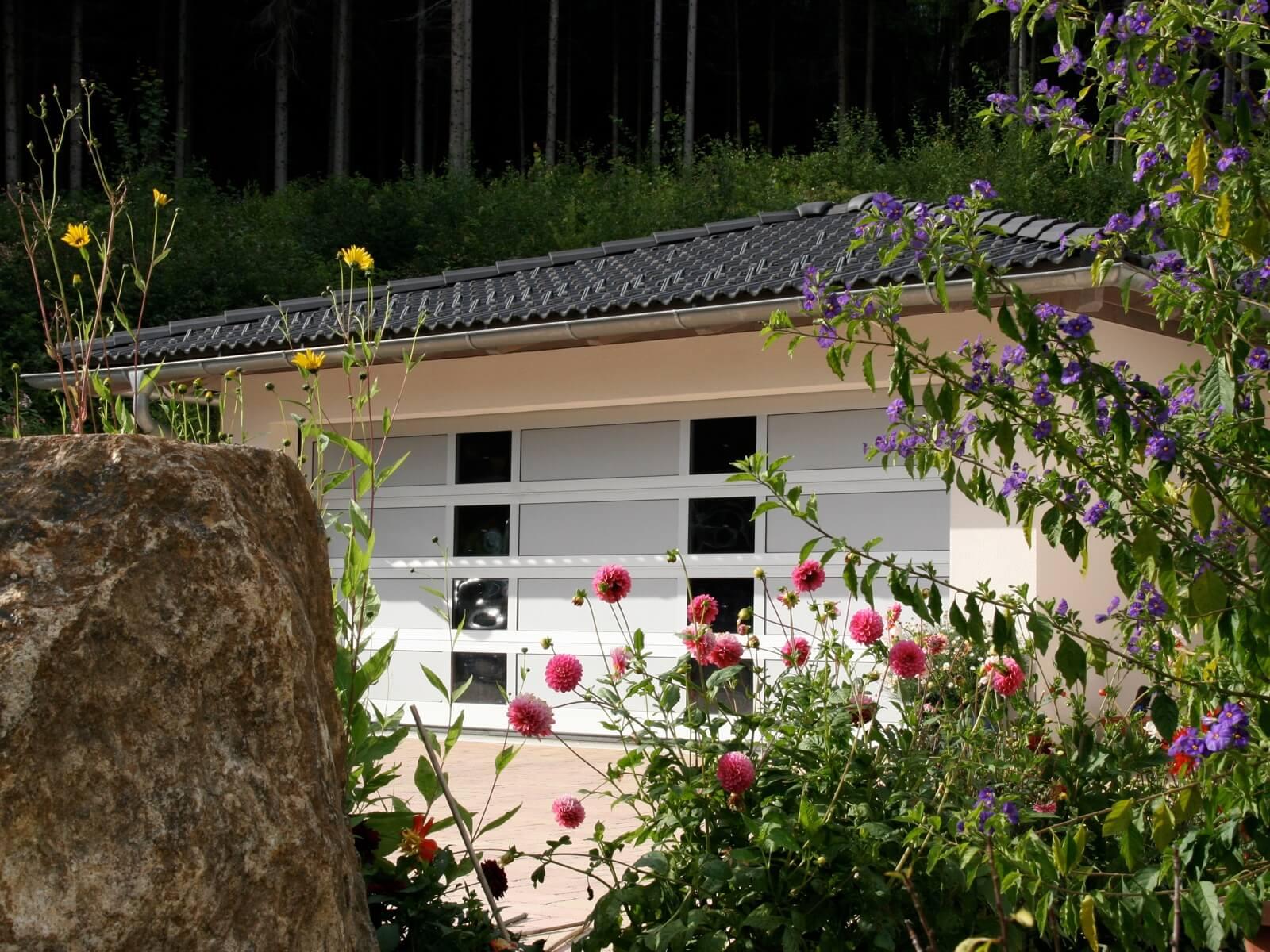 Portone sezionale vetrato LUXOR - Ossidato naturale con tamponamenti