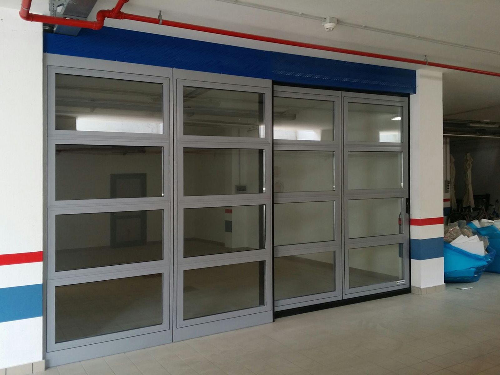 Portone scorrevole industriale ATLANTE con vetrature